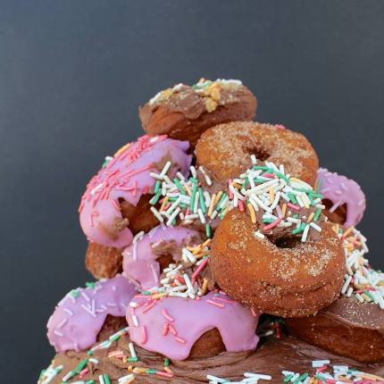 tmff double chocolate buttercream layer cake topped with loads of mini donuts